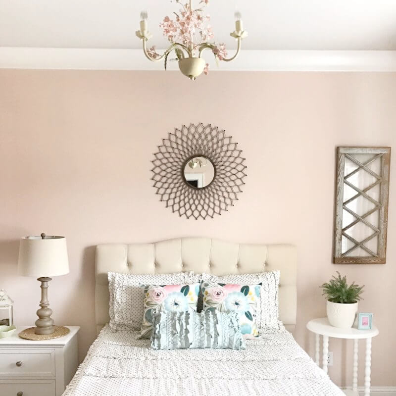 bedroom with tan bed and walls painted Magnolia Ella Rose