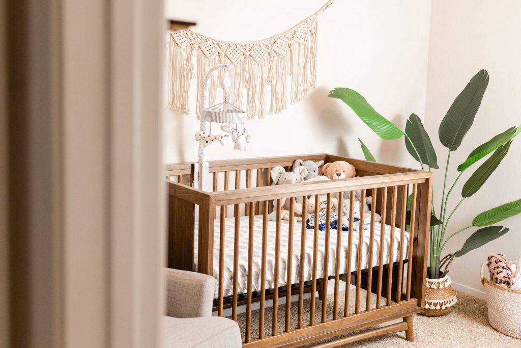 boho neutral nursery with wood crib