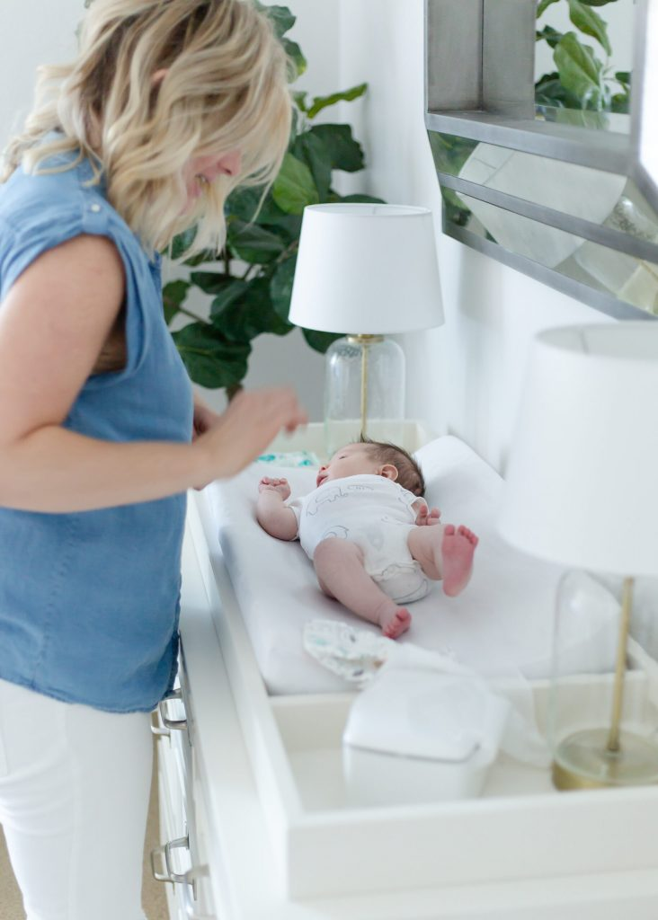 mom with baby on changing table