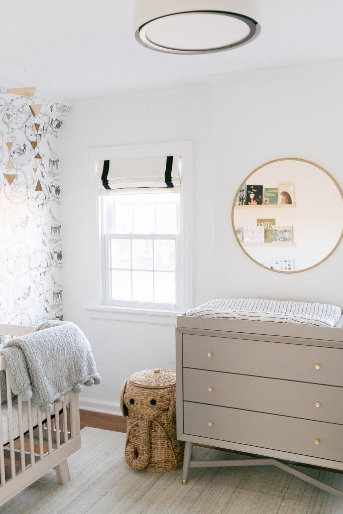 nursery with greige dresser and white walls
