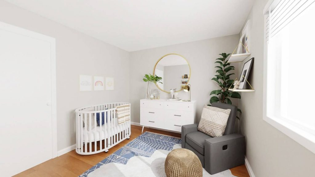 white oval crib in nursery with white dresser and gray glider