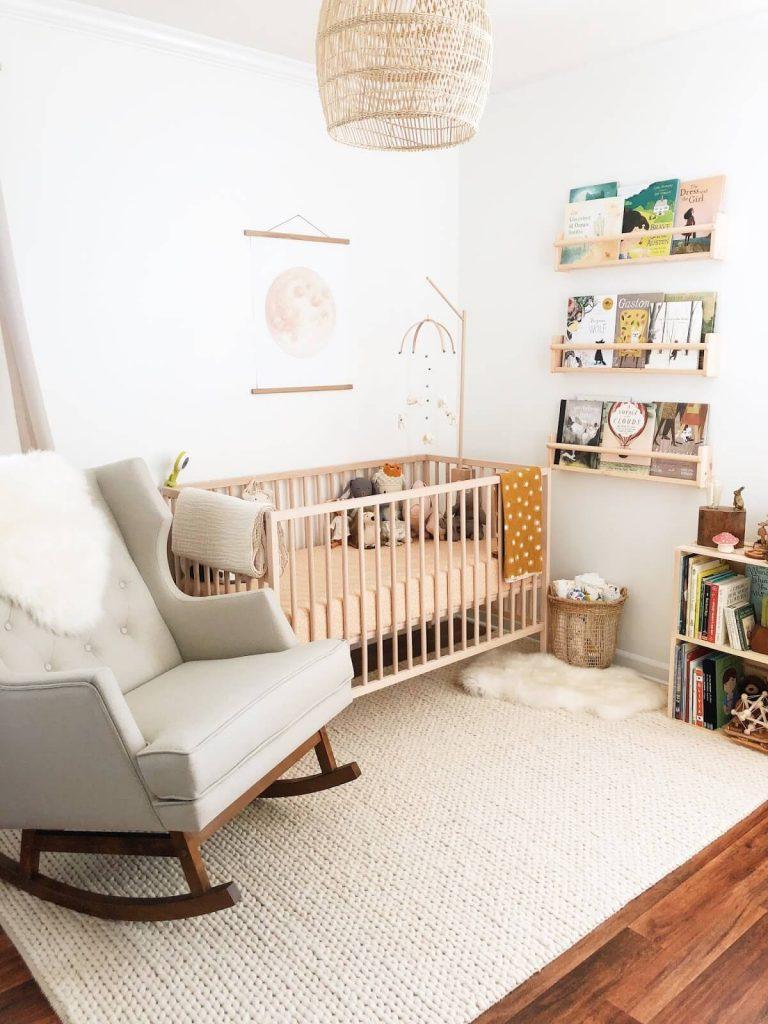 modern minimalist nursery design with wood crib. and gray glider rocker