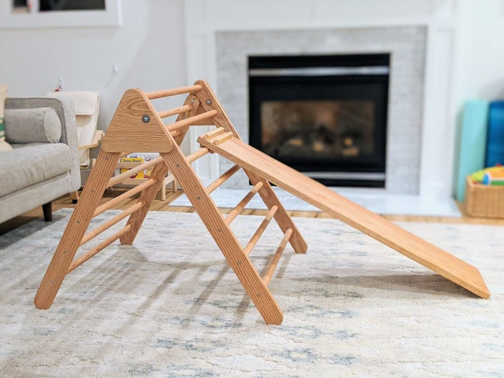 pickler triangle with slide inside in front of fireplace
