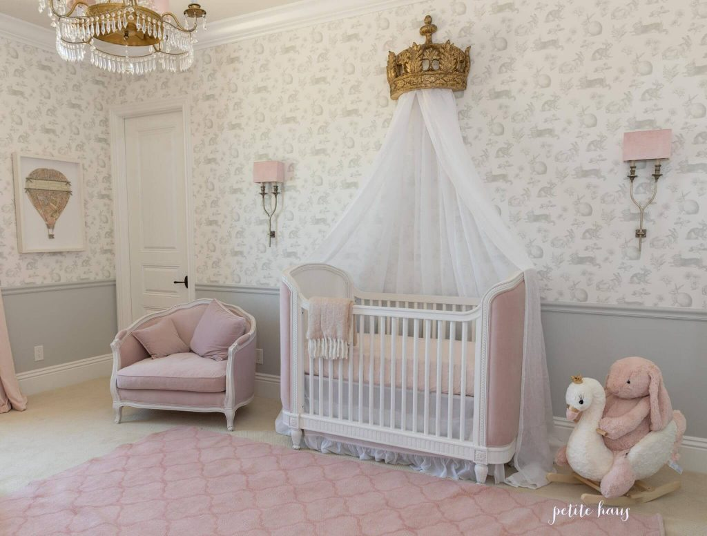 princess nursery with gold crown on the wall and pink rug