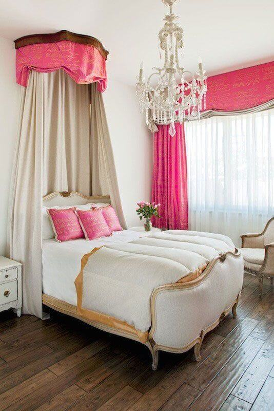 hot pink canopy with tan shades and upholstered bed with hot pink curtains in princess teen room