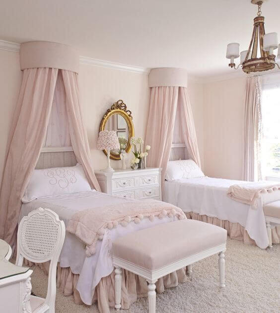 pink princess room with 2 beds and pink canopies on the wall