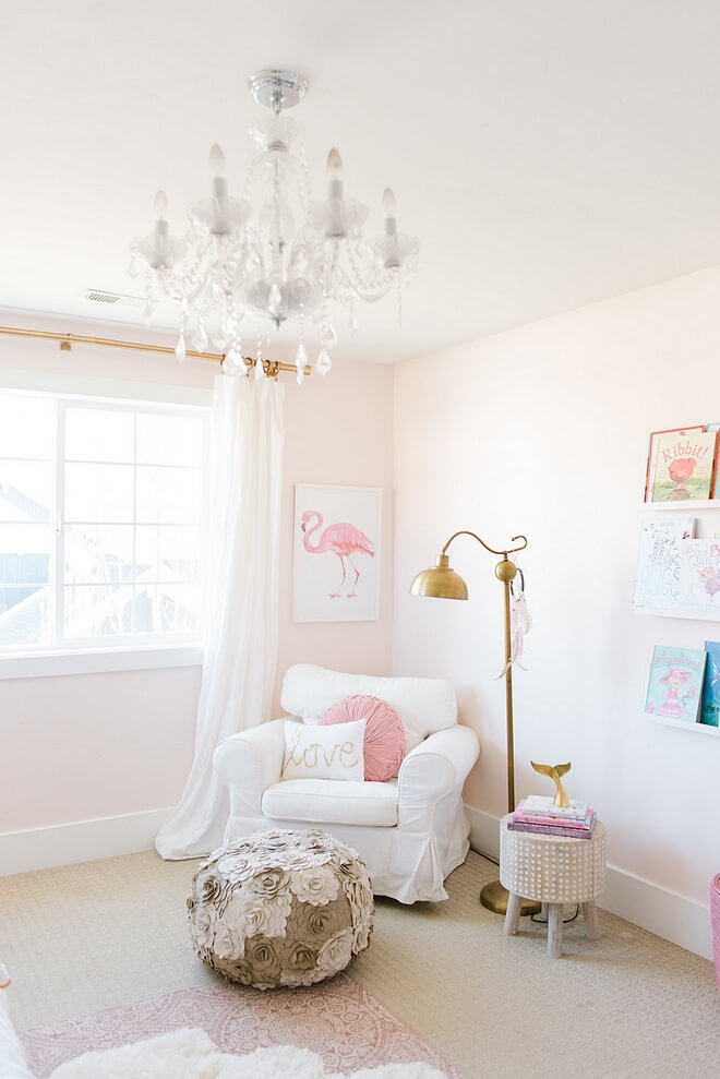 white glider in nursery with gold floor lamp and sherwin Williams