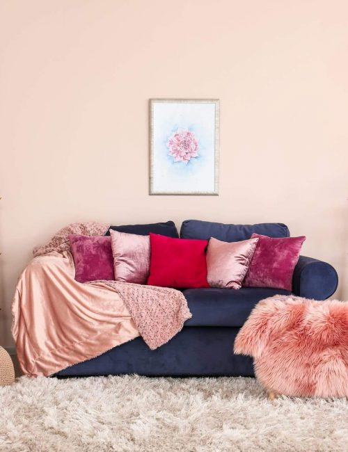 navy denim couch with wall painter Sherwin Williams Romance