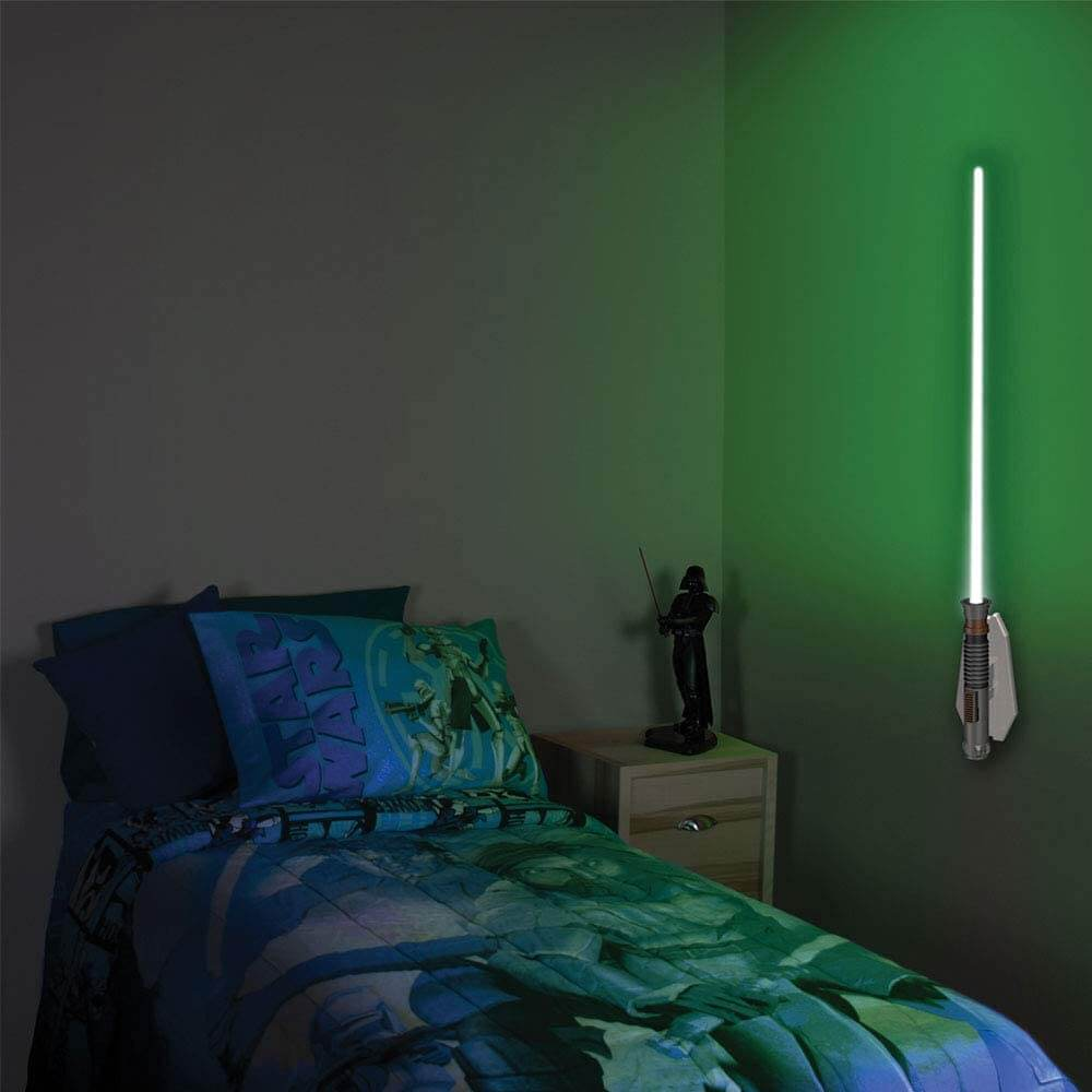 dark room with green lightsaber on the wall
