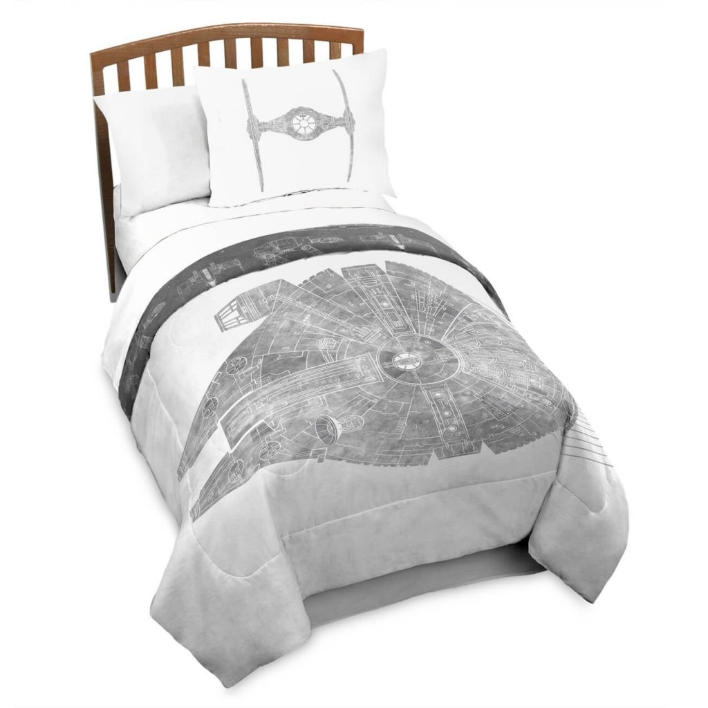 Star Wars Millennium Falcon comforter on wood bed with white background