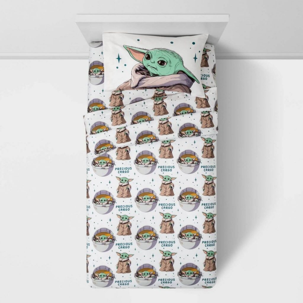 top view of bed with baby Yoda and Mandelorian sheet set