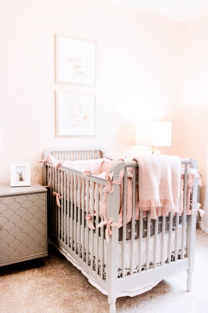 white crib with pink bedding and pink walls
