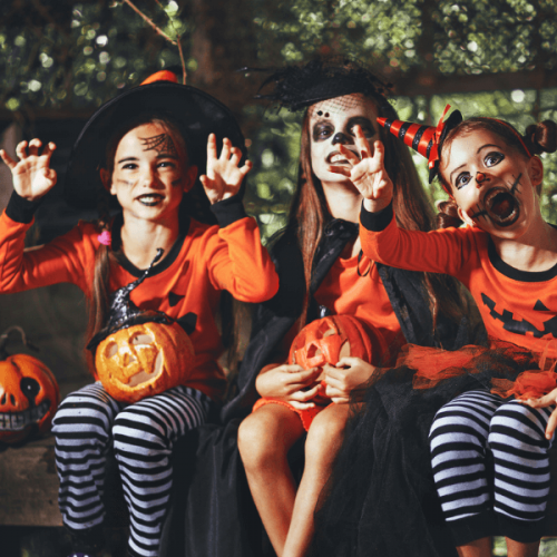 3 kids with face painted dressed up for Halloween